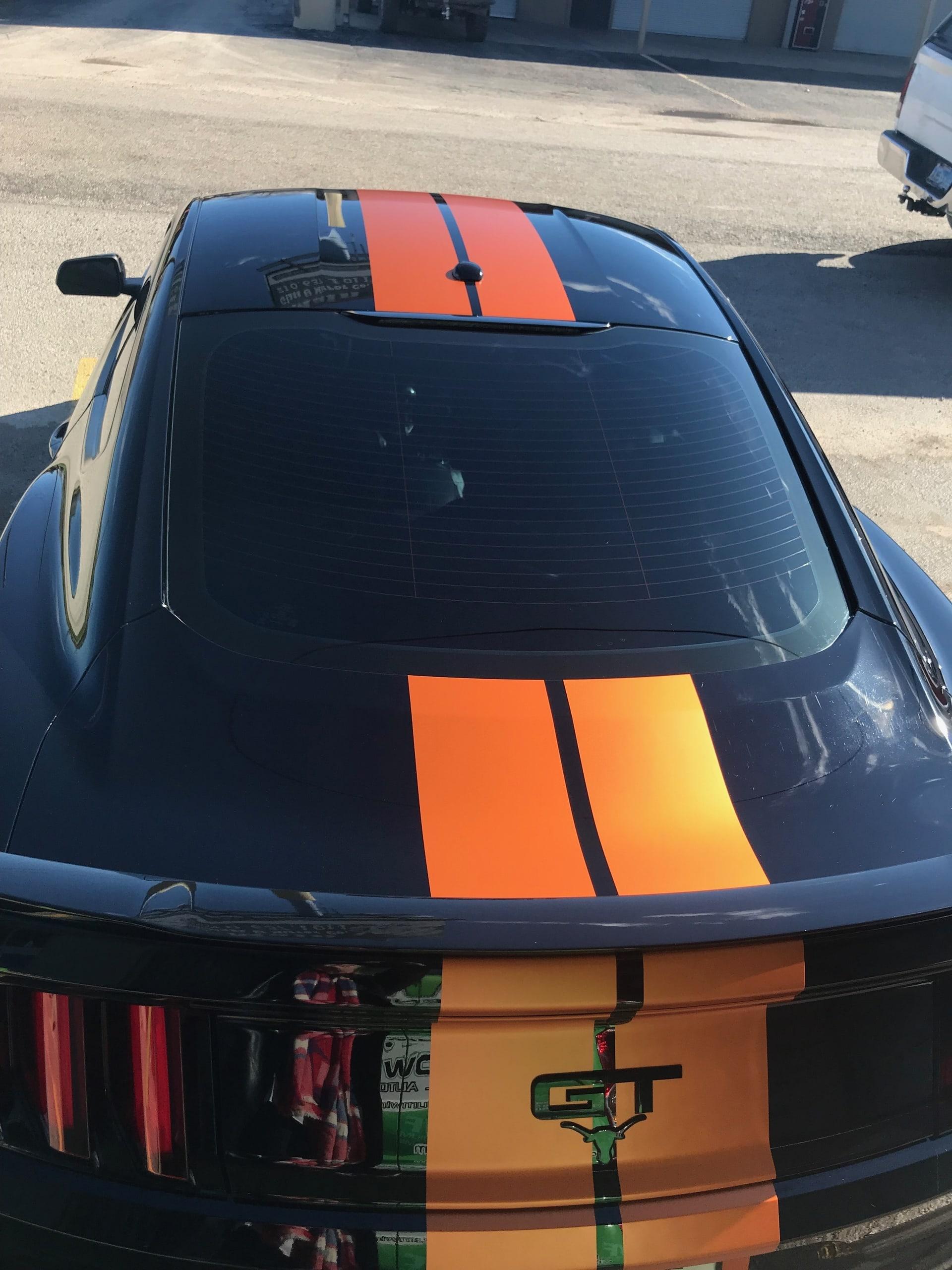 Longhorn Orange race stripes added to black Mustang GT